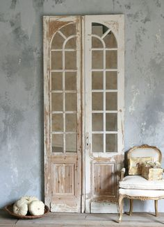 VINTAGE MIRROR DOORS: back entry; clear glass on the upper panes to let in light