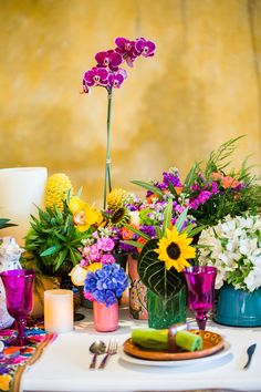 Colorful floral centerpieces | Elizabeth Medina Photographic Artisans | see more on: http://burnettsboards.com/2015/01/colorful-yucatan-hacienda-wedding/
