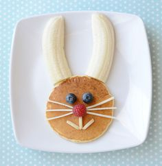Finished! Pancake bunny head with banana ears, blueberry eyes, raspberry nose, slivered-almond mouth and apple whiskers.