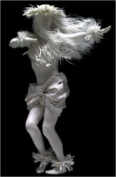 ' Hula Girl' a handmade paper sculpture by Patty and Allen Eckman .