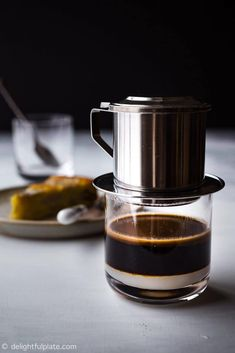 How to Make Vietnamese Coffee (Cafe Sua Nong) the authentic way with a phin coffee filter. Recipe includes step-by-step photos and video showing you how quick and easy it is to brew this traditional Vietnamese hot coffee with sweetened condensed milk. Coffee Tasting, Coffee Cafe, Coffee Drinks, Coffee Shop, Beverage Drink, Coffee Brewer, Coffee Lovers, Great Coffee, Hot Coffee