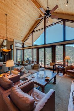 Big Mountain Living Room Design Ideas, Pictures, Remodel and Decor... Interesting mix of the light knotty pine above and the darker woods in the floor and trim.