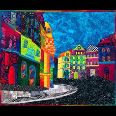Here is an art quilt that details a scene in Prague.  I like the bright colors.