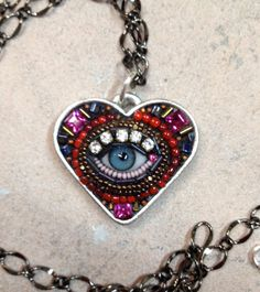 Bought one in NOLA.  Small Eye Heart Pendant Necklace blue by betsyyoungquist on Etsy. $140.00, via Etsy.