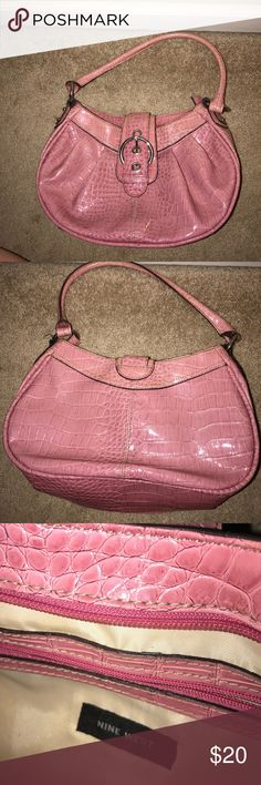 Pink Nine West Purse Cute pink bag from Nine West. Has one zipper pouch and two small compartments. Hardly used. Nine West Bags Totes