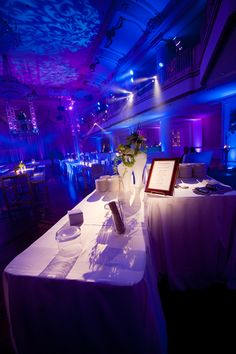 Color changing LED wall washing, intelligent lighting, ceiling wash, pin spotting, and suspended DJ booth, and DJ entertainment for a corporate event. Photo by Joe Bleiler of Jennifer Childress Photography. Wedding lighting, special event lighting, event production,