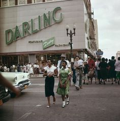 +~+~ Vintage Photograph ~+~+   Awesome photograph taken in Houston in 1956.  I love the continuation of the green in the store signage, the girls dress and the car.