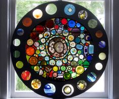Stained glass rose window kaleidoscope, made from recycled glass bottles and historic stained glass.