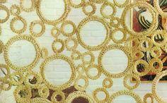 Como hacer una cortina de anillas de diferentes tamaños forradas con hilo, en crochet.