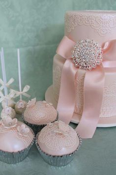 Pink cupcakes with sugar veil, blossom and butterfly details (to match main cake) - Cakes and biscuits By Lisa. Photo only.
