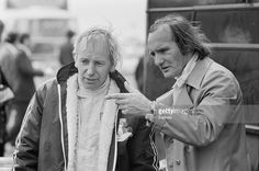 British racing drivers John Surtees (left) and Mike Hailwood (1940 - 1981) practise for the Daily Express International Trophy (BRDC International Trophy) at Silverstone, UK, 6th May 1971.