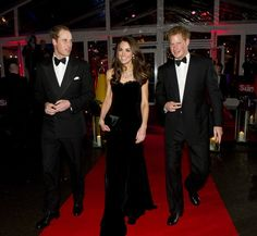 Prince William, Duke of Cambridge, Catherine, Duchess of Cambridge and Prince Harry attend The Sun Military Awards at Imperial War Museum on December 19, 2011 in London, England. (Photo by Arthur Edwards - WPA Pool/Getty Images)