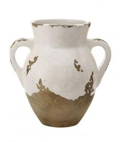 Tuscan Small Double Handled Urn: Filled with a handful of fresh blooms and set out on an outdoor table or on top of a bookshelf, this hand-glazed terracotta vase gives a room a warm, rustic vibe.