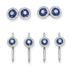 A SAPPHIRE AND DIAMOND DRESS SET   Comprising a pair of cufflinks, each double-link set with a collet-set diamond, within a calibré-cut sapphire and circular-cut diamond two-tiered surround; and four shirt studs en suite, mounted in platinum and 18k white gold