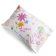 PARTY PILLOW hand-decorated pillowcases to take home as favors, everyone can sleep on their memories for nights to come. During the party, pass out felt-tipped fabric pens and prewashed white pillowcases (slip a piece of cardboard inside each case to keep the ink from seeping through to the other side). Then the kids can embellish their individual cases with drawings and favorite slogans.