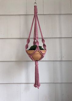 Your place to buy and sell all things handmade Excited to share this item from my shop: Chunky macrame plant hanger: cotton cord, metal ring Macrame Plant Holder, Plant Holders, Metal Plant Hangers, Macrame Bracelet Tutorial, Cotton Cord, Hanging Pots, Macrame Projects, Dorm Decorations, Plant Decor