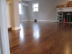 Retro Ranch Reno: Original Oak Floors sanded and stained using Minwax's Jacobean, with a Satin finish