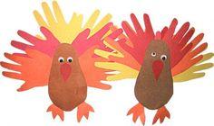 Kids hand and feet prints make turkies. Thanksgiving art project K-2
