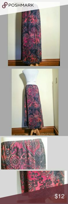 """BOGO Jones New York Maxi Skirts - Bundle of 2 These stunning fully lined maxi skirts have been washed but never worn & hung to dry. The floral beige is in excellent condition.  Free is the blue, orange, red, purple, & white in wonderful condition, except for a small snag about a foot up from the bottom-a little bit over from the right seam. I can't see it unless I look for it. It is shown in the 3rd photo.  The measurements across are: elasticized waist 14"""", hips 21"""". The length is 37""""…"""