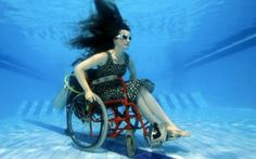 Artist Sue Austin has created an underwater wheelchair with a propeller and fins that allow her to steer through the deep ocean.