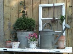 Old window, watering can and bucket.love this for cluster idea at the barn.
