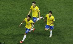 Running the show: Neymar (left) is jubilant after scoring Brazil's first goal of the World Cup