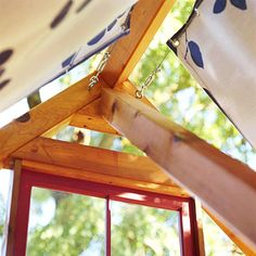To create the roof, stretch wires across the roof beams and fabric panels with grommets can slide open/closed.  Use a clamp claw to attach the wire to a turnbuckle, which attaches to the eye screws fastened to the wood frame.