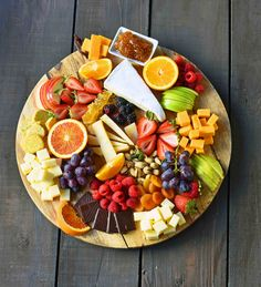How to make the BEST Fruit and Cheese Board ndash Modern Honey-How to make the BEST Fruit and Cheese Board. An assortment of cheeses, fresh fruits, dried fruits, nuts, and spreads. A perfect party appetizer platter. Cheese Fruit Platters, Cheese And Cracker Tray, Party Food Platters, Food Trays, Meat And Cheese, Cheese Platters, Wine Cheese, Best Cheese Platter, Charcuterie Cheese