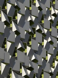Architects: Allies and MorrisonAllies and Morrison - Car Park in Sheffield - The cladding forms an uncompromising homogeneous surface to the car park's cubic volume. There is an interesting contradiction here, as when a plain, demu