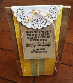 Brown paper package, tied up with string, filled with some of my favorite things.  I LOVE this idea.
