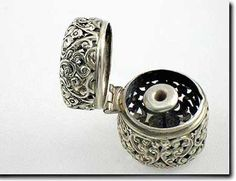 Unger Brothers sterling silver repoussé sewing thimble holder
