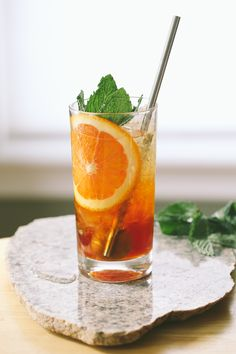 Sweet Vermouth Cobbler - muddled citrus (typically orange), some sugar, liquor and garnished with seasonal fruit (citrus and berries) and mint. Sherry and vermouth are often a bit thicker in consistency and so a bit of soda water will help cut it.