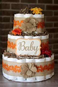READY TO SHIP - SHIPS NEXT BUSINESS DAY ((Made with 62 size 1 HONEST diapers!!)) This gorgeous 3 tier Fall Baby cake is perfect for a fall baby shower - displaying on a mantle or as table centerpieces! Measures approx. 14 tall and 10 wide. Colors can be changed to fit your theme. This cake comes fully assembled - wrapped in tulle, ready to display at your special event. >>> Other Sizes Options <<< --Mini cakes (10 diapers) --Lg single tier (20 diapers) --2 tier (27 diapers) <<<- 2 WEEK LE...