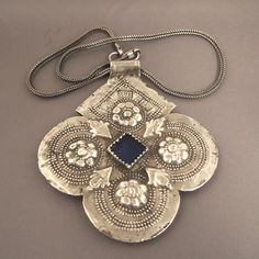 Morocco | 'Foulet Khamsa' pendant from Essaouira | ca. 1919 | Silver and glass paste | © Michael Halter.
