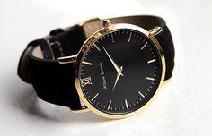 William Strouch Black & Gold Watch