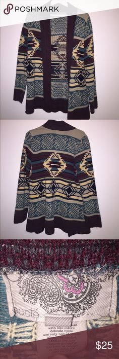 Urban Outfitters Aztec Knit Sweater Cardigan Urban Outfitters Aztec knit sweater Cardigan. Gently worn but still great condition. Perfect for warm and cozy days/nights. Size large Urban Outfitters Sweaters Cardigans