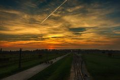 Sunset at the unloading ramp of the Auschwitz II-Birkenau camp.