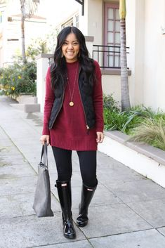 winter leggings outfit with maroon tunic sweater and black leggings and black quilted vest with black rain boots and gray tote and gold pendant necklace with gold leather earrings Source by micaespindola sweater outfit Leggings Outfit Winter, Maroon Leggings, Black Leggings, Maroon Sweater, Black Rain Boots, Outfits With Rain Boots, Outfits With Vests, Cardigan Outfits, Sweater Dresses
