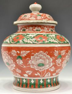 """ANTIQUE CHINESE ENAMELED EARTHENWARE LIDDED URN, of baluster form, decorated with scrolling foliage on a red and green ground, 15.25""""h"""