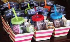 Girls night out gift basket ideas: reusable mugs, toe separators, nail polish, a mini candle, a pumice stone, bath salts, a mud mask, a headband to keep the mud mask out of their hair, lip balm, and a couple big bars of the Ghirardelli Intense Dark chocolate.: