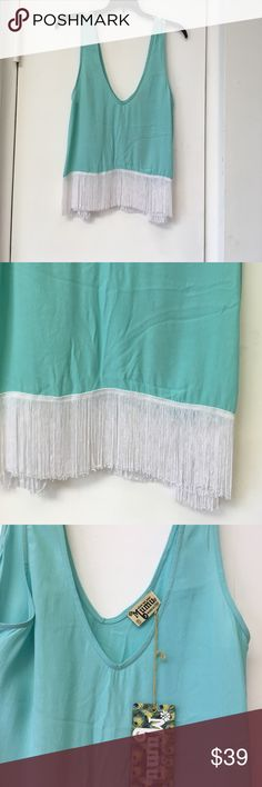 New Show Me Your Mumu SZ M Fringed Tank Top New Show Me Your Mumu SZ M Fringed Tank Top . Light turquoise V- neck tank top. Fringes all along bottom of tank. Show Me Your MuMu Tops Tank Tops