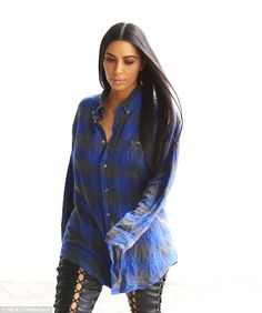 Long hair, don't care: Kim's lengthy locks were styled bone straight and cascaded over opposite sides of her shoulders