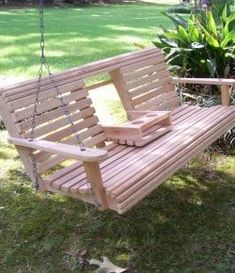 691c879f Unwind in your yard with a DIY wood porch swing with cup holders!