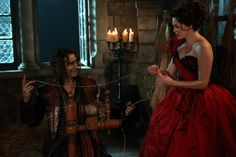 Rumplestiltskin (Robert Carlyle) and a young Cora (Rose McGowan)