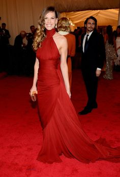 Hilary Swank was the epitome of grace and glamour  in Michael Kors custom made crimson chiffon gown.