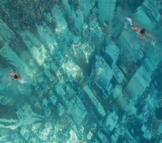 """The eye-catching swimming pool in Mumbai, India, has been built to raise awareness about the threat of sea level rises as a result of global warming.  It was constructed by attaching a giant aerial photograph of the New York City skyline to the floor of the pool."""