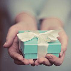 tiffany's gift photograph / blue christmas, present, hands, robins egg blue, tiffany blue, bow, ribbon / a gift / 8x8 fine art photo. $28.00, via Etsy.