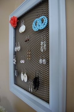 Earring storage - picture frame and decorative radiator grate. I'm doing this!