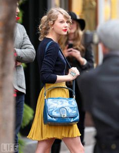 Navy cable sweater, yellow pleated skirt, light blue fendi purse + soft curls... I knew I liked Taylor for a reason :)