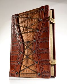 http://danybuffy.deviantart.com/art/Large-Leather-Corset-Journal-11-x-8-inches-407232993